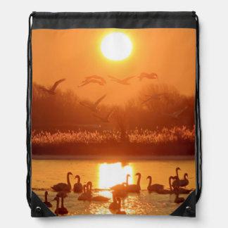 Swans at Sunrise Drawstring Bag