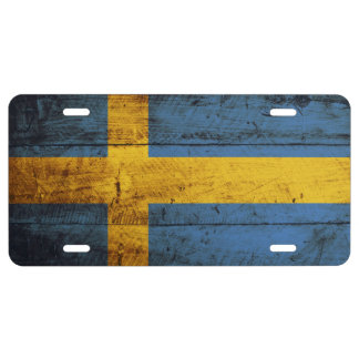 Sweden Flag on Old Wood Grain License Plate