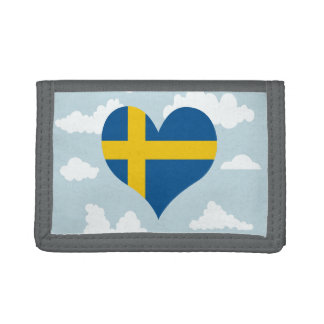 Swedish Flag on a cloudy background Trifold Wallets