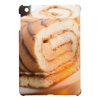 Sweet cake with chocolate cream and cup of hot tea case for the iPad mini