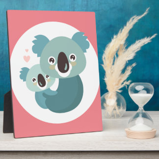 Sweet cartoon koala mother and baby hugging plaque