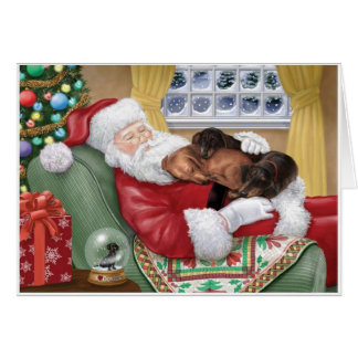 Sweet Dachshunds resting on Santa's Lap Card