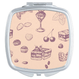 Sweet pattern with various desserts. compact mirrors