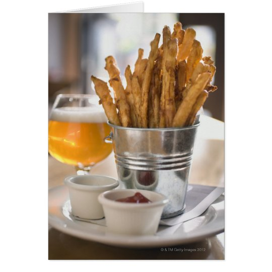Sweet potato fries served with vinegar and card