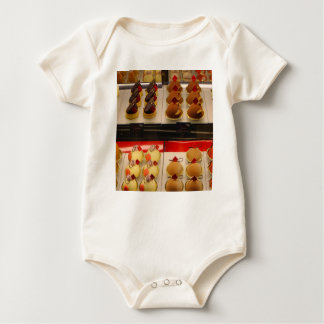 Sweet treats on display minus one baby bodysuit