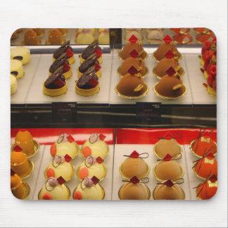 Sweet treats on display minus one mouse pad
