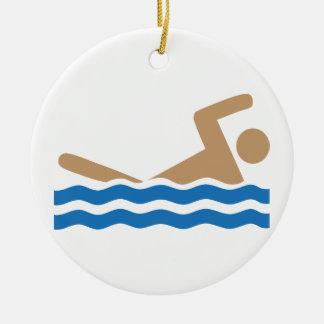 Swimming icon pictograph in color round ceramic ornament