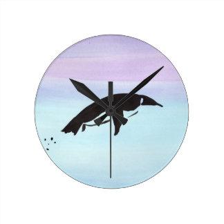 Swimming Penguin Clocks