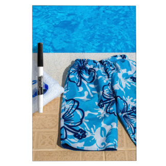 Swimming trunks goggles and towel at pool dry erase whiteboard