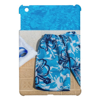 Swimming trunks goggles and towel at pool iPad mini covers