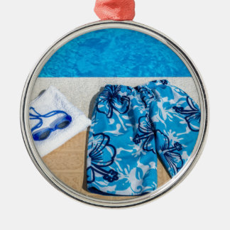 Swimming trunks goggles and towel at pool Silver-Colored round ornament