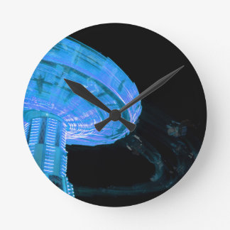 swings ride in blue fair midway carnival image wall clock