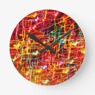 Swirling Neon Lights Glowing Round Wall Clocks