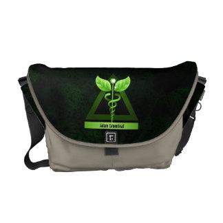 Symbole médical de caducée vert de médecine douce sacoches