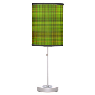 Table lamp with green plaid print on shade