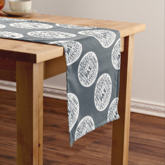 Table runner with multilingual peace design