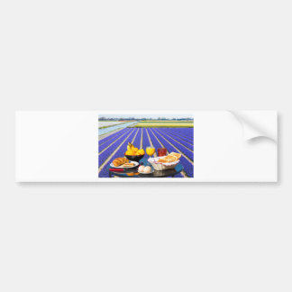 Table with food and drink near flowers field bumper sticker
