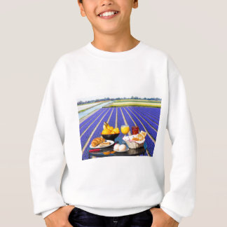 Table with food and drink near flowers field sweatshirt
