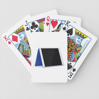 Tablet computer on white bicycle playing cards