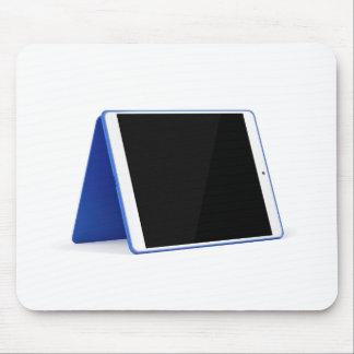 Tablet computer on white mouse pad