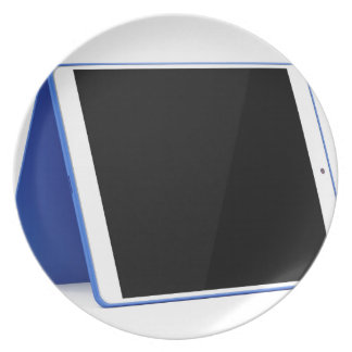 Tablet computer on white plate