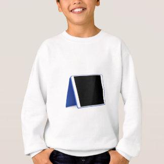 Tablet computer on white sweatshirt
