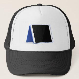 Tablet computer on white trucker hat