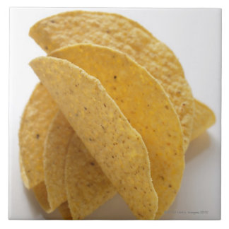 Taco shells on white background tile