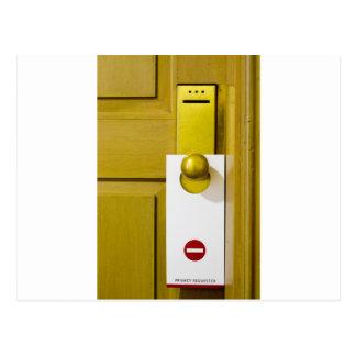 Tag on door handle postcard