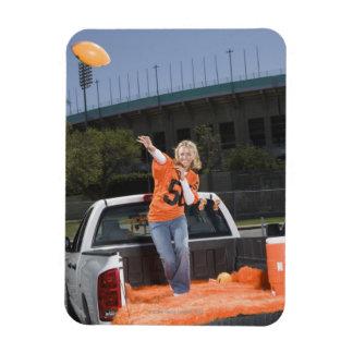 Tailgating woman throwing football rectangular photo magnet