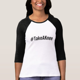 #TakeAKnee, bold black text on white T-Shirt