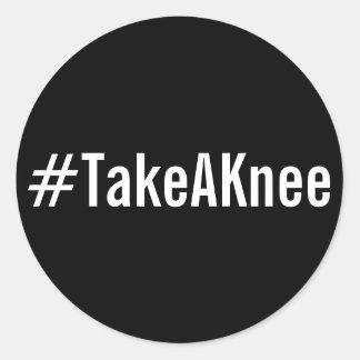 #TakeAKnee, bold white text on black stickers