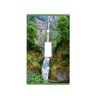 Tall waterfall off a cliff with green trees light switch cover