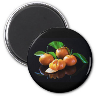 Tangerines On A Black Background 2 Inch Round Magnet
