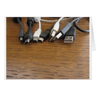 Tangle of dusty computer cables with sockets card