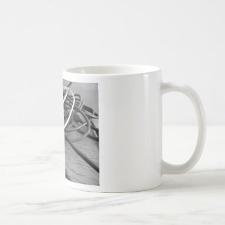Tangle of dusty computer cables with sockets coffee mug