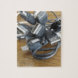Tangle of dusty computer cables with sockets jigsaw puzzle