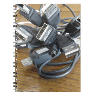 Tangle of dusty computer cables with sockets notebook