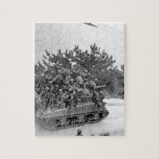 Tank-borne infantry moving up to take_War Image Puzzles