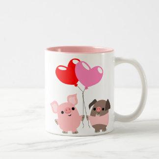 Tasse embrouillée de coeurs (porcs de bande dessin