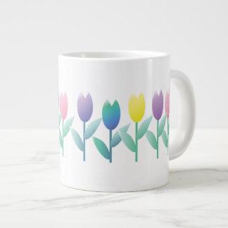 Tasse enorme à la maison de tulipes de ressort de
