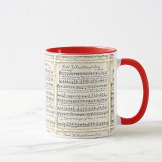 Tasse vintage de musique de feuille de Noël