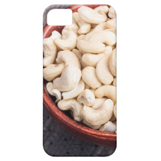 Tasty and healthy raw cashew nuts in a brown bowl iPhone 5 case