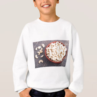 Tasty and healthy raw cashew nuts in a brown bowl sweatshirt