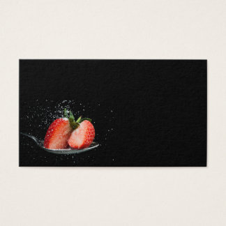 Tasty strawberry on a spoon with sugar business card