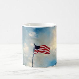 Tattered Flag in Winds of Change Coffee Mug