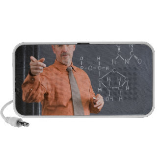 Teacher by chalkboard with structure of chemical notebook speakers