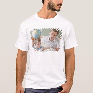Teacher helping student with homework T-Shirt