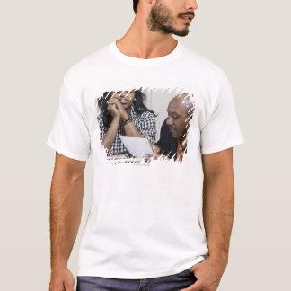 Teacher talking to student in classroom T-Shirt
