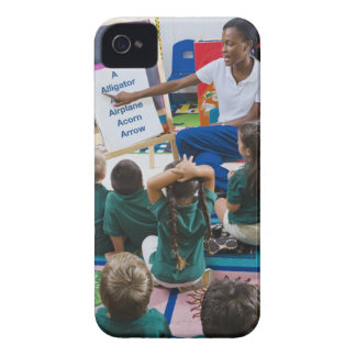 Teacher with preschool students in classroom iPhone 4 cover